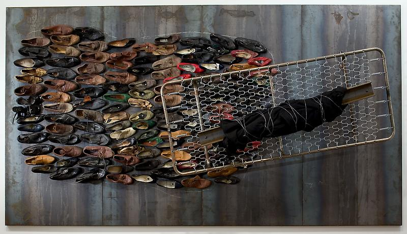 Jannis Kounellis 	UNTITLED, 2006 	Iron plates, shoes, bed frame, steel hooks, I-beam, coat, wire 	78.74 x 141.73 inches 	200 x 360 centimeters