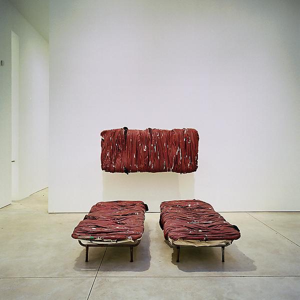 Jannis Kounellis 	UNTITLED, 2006 	three bed frames, wrapped fabric painted red 	74.8 x 35.43 x 11.81 inches - approximate measurement of each bed frame 	190 x 90 x 30 centimeters