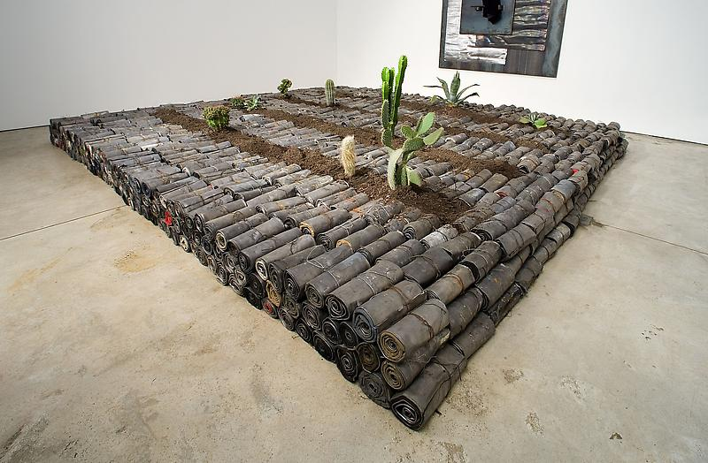 Jannis Kounellis 	UNTITLED, 2005 	Lead, earth, cactus, fragments of clothing 	12 x 157 1/2 x 157 1/2 inches 	30 x 400 x 400 centimeters
