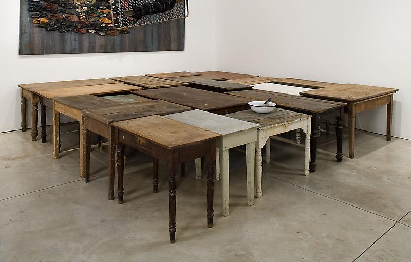 Jannis Kounellis 	UNTITLED, 2006 	Found wooden tables, bowl, knife, red fish 	32 x 172 x 179 inches 	81.3 x 436.9 x 454.7 centimeters