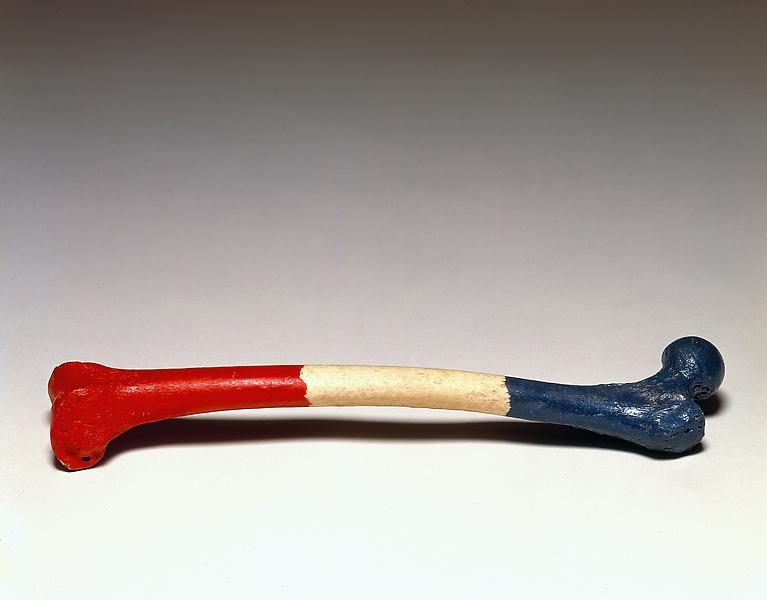 Marcel Broodthaers (1924 – 1976) 	FEMUR D'UNE FEMME FRANCAISE, 1965 	Painted human thigh bone 	3 9/16 x 16 15/16 x 3 1/2 inches 	9 x 43 x 8.9 centimeters