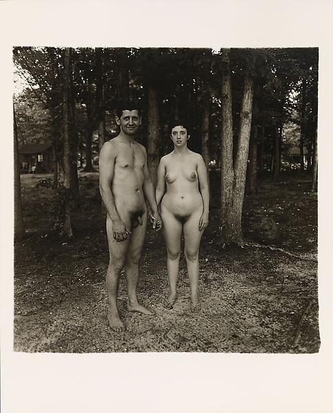 Diane Arbus (1923 - 1971) 	A husband and wife in the woods at a nudist camp, N.J. 1963 	Gelatin silver print 	20 x 16 inches 	50.8 x 40.6 centimeters 	Copyright © The Estate of Diane Arbus.