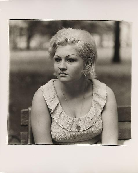 Diane Arbus (1923 - 1971) 	Woman with a locket in Washington Square Park, N.Y.C 1965 	Gelatin silver print 	20 x 16 inches 	50.8 x 40.6 centimeters 	Copyright © The Estate of Diane Arbus.