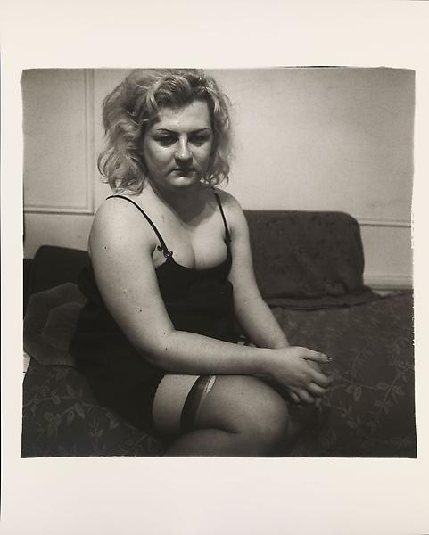 Diane Arbus (1923 - 1971) 	Transvestite with torn stocking, N.Y.C 1966 	Gelatin silver print 	20 x 16 inches 	50.8 x 40.6 centimeters 	Copyright © The Estate of Diane Arbus.