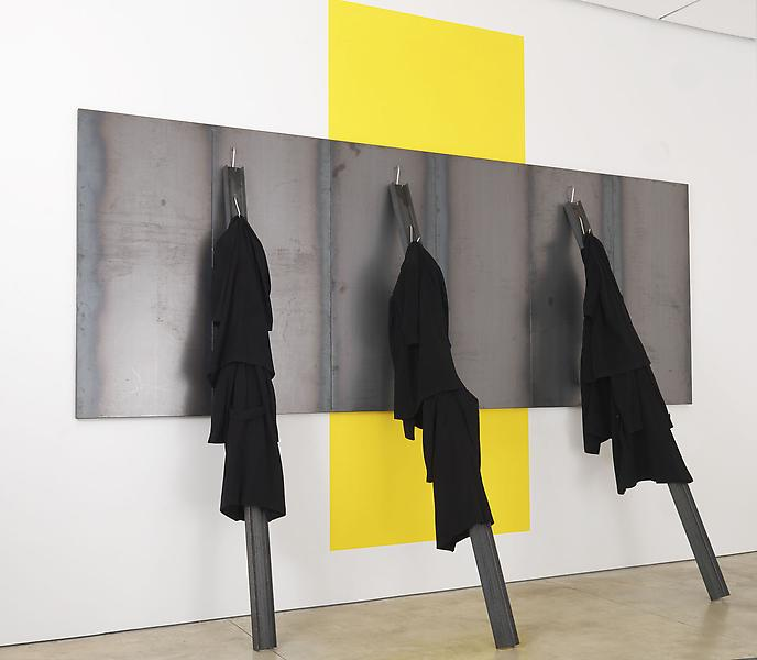Jannis Kounellis UNTITLED 2013 Steel and coats 10 feet 10 inches x 17 feet 8 1/2 inches x 59 inches 330.2 x 539.8 x 149.9 centimeters 130 x 212 1/2 x 59 inches