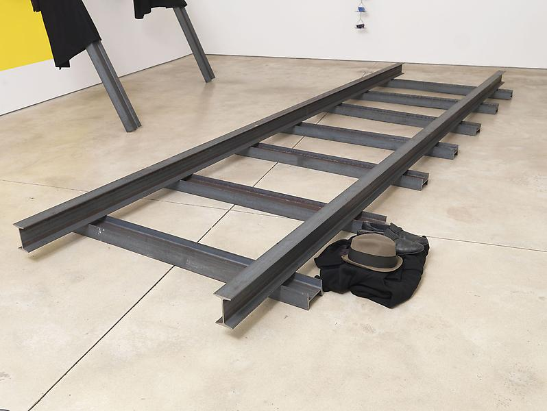 Jannis Kounellis UNTITLED 2013 Steel and clothing 8 1/4 inches x 16 feet x 60 inches 21 x 516.9 x 152.4 centimeters 11 1/2 inches x 60 inches