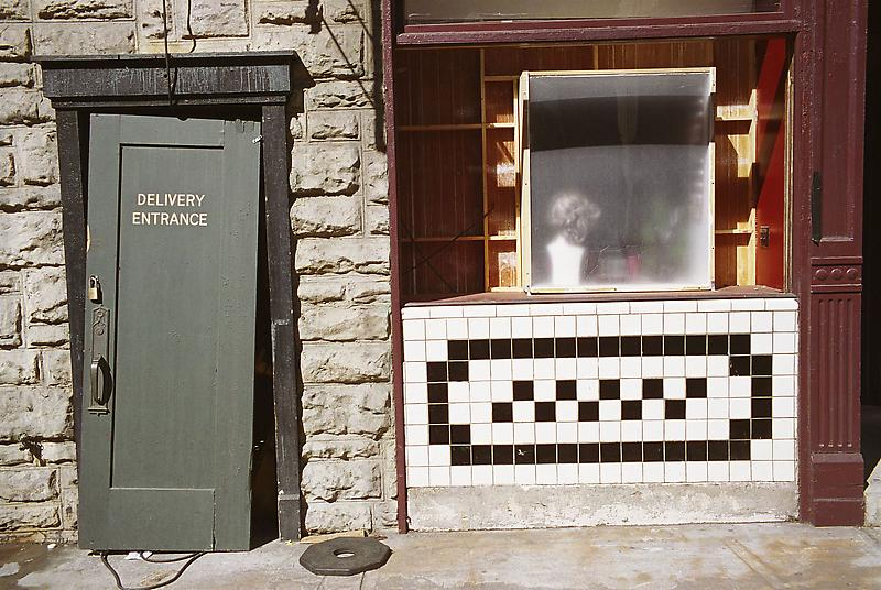 William Eggleston 	UNTITLED (DOOR, WHITE AND BLACK TILE, PARAMOUNT LOT) 2000 	Pigment print 	22 x 28 inches 	55.9 x 71.1 centimeters
