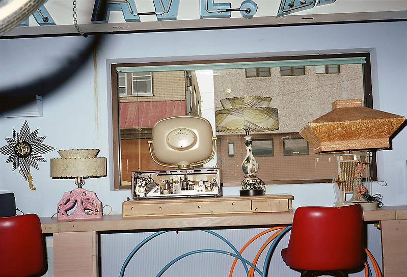 William Eggleston 	UNTITLED (ROOM WITH OLD TV, LAMPS, WILDWOOD, NEW JERSEY) 2002 	Pigment print 	22 x 28 inches 	55.9 x 71.1 centimeters