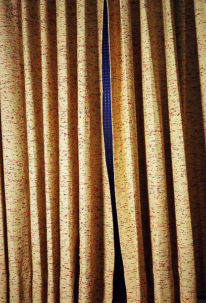 William Eggleston 	UNTITLED (CURTAINS, SLIT, NORMAN PETTY STUDIOS, NEW MEXICO) 2004 	Pigment print 	28 x 22 inches 	71.1 x 55.9 centimeters