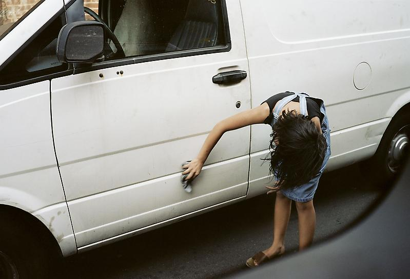William Eggleston 	UNTITLED (WOMAN WIPING VAN, QUEENS, NEW YORK) 2002 	Pigment print 	22 x 28 inches 	55.9 x 71.1 centimeters