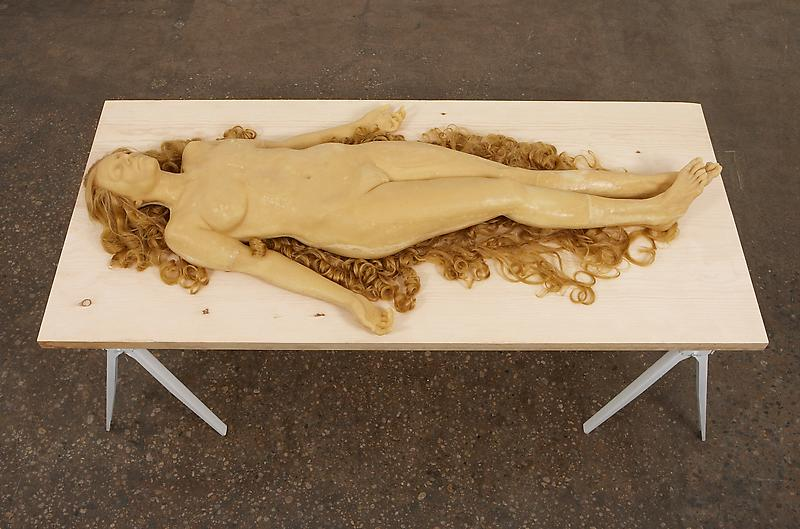 Vanessa Beecroft 	BLONDE FIGURE LYING 2008 	Water resin, coated with beeswax, human hair 	77 x 36 x 10.2 inches 	195.6 x 91.4 x 25.9 centimeters