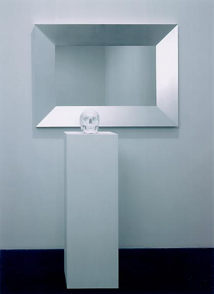 Katharina Fritsch 	PICTURES WITH MIRROR AND SKULL, 1998 	Aluminum, glass, wood, lacquer, porcelain and paint 	39 5/8 x 55 3/8 x 2 5/16 inches - mirror 	100.6 x 140.7 x 5.9 centimeters 	7 7/8 x 5 3/4 x 9 7/8 inches - skull 	20 x 14.6 x 25.1 centimeters