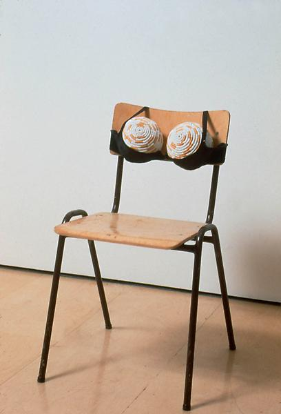 Sarah Lucas 	CIGARETTE TITS II [IDEALIZED SMOKER'S CHEST II] 1999 	Chair, two footballs, cigarettes and bra 	32 1/4 x 23 5/8 x 19 5/8 inches 	81.9 x 60 x 49.8 centimeters